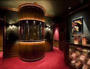 The theater's entry includes a ticket booth and two concession stands with popcorn maker. The film library includes more than 1,400 titles.The history:Unfortunately, Erlys Spitzer took ill and passed away in 2007. Frank Spitzer subsequently put the mansion up for sale again.