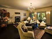 Three spacious suites in the guest wing, each with their own baths, share a parlor and kitchenette.