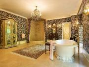 The master suite also includes his-and-her baths.For more images of the estate, click here.