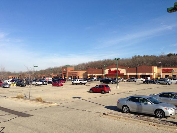 The center is anchored by a Sentry grocery store with a long-term lease.
