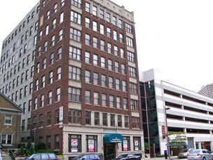 Associated Bank NA has decided to auction off this 8-story office building at 828 N. Broadway.