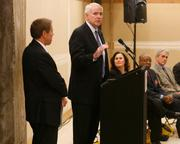 "Milwaukee Mayor Tom Barrett speaks at a press conference Monday at a ceremonial ""wall smashing"" event. Barrett is joined, from left, by Ed Carow, managing partner of Jackson Street Management; Stephanie Klett, Department of Tourism secretary; Wyman Winston, executive director of WHEDA; and Milwaukee Ald. Bob Bauman."