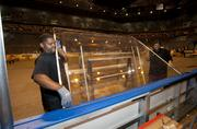The glass around the hockey dasher boards is installed.