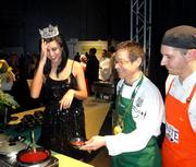 Kaeppeler and D'Amato share a laugh while serving guests.