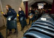 Marquette students help start the changeover by bringing their seats up to the Bradley Center's main concourse level.