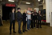 Styx band members pose with Green Bay Packers linebacker coach Kevin Greene before the show. Greene is showing off his Super Bowl XLV ring.