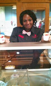 """Cocoa coach"" Nisha Spivey offers hot fudge sundaes."