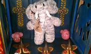 The store sells elephant-related gifts, such as stuffed toys and jewelry.
