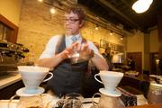 Christian Ott, head barista at Stone Creek, demonstrates a coffee-brewing technique.