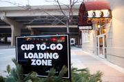 "The cafe offers a ""loading zone"" with temporary parking to pick up coffee."
