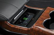 The seat console also includes a charging and connecting dock for mobile devices.