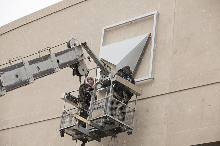 Workers installed signs at the Delta Center earlier this year.