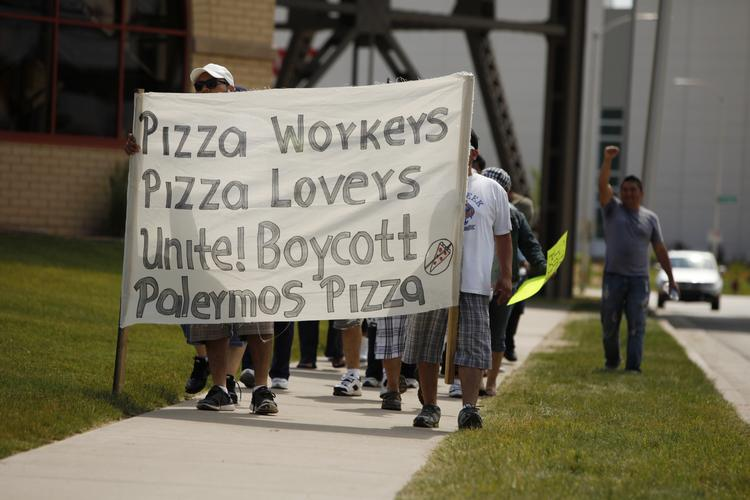 Workers picket outside the Palermo Villa Inc. pizza plant in Milwaukee's Menomonee  Valley.