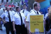 First officer Carl Schwerman and captain Craig Moffett, standing left, gather with other protestors in New York City.
