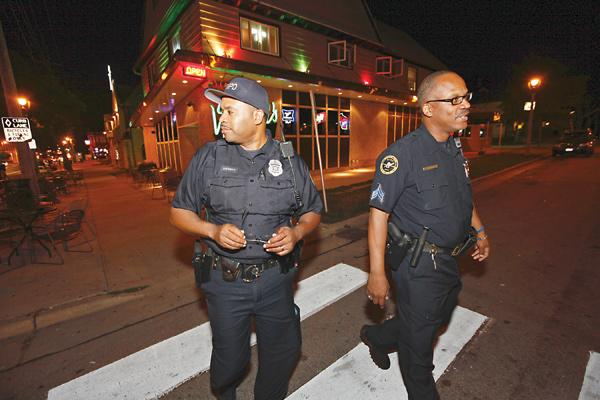 Milwaukee Police Department Sgt. Kenneth Harris (at right) and officer James Luckett on North Water Street during a Code RED patrol in August.