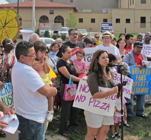 Christine Neumann-Ortiz, Voces de la Frontera executive director, speaks in front of Palermo union supporters in August.