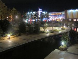 The Bricktown Canal shines at night. The Harkins Bricktown Cinema 16-theater complex opened after the city built the canal.