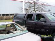 Tornado and high winds damaged employees' cars in the parking lot.