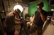 Shalhoub prepares before shooting a video.