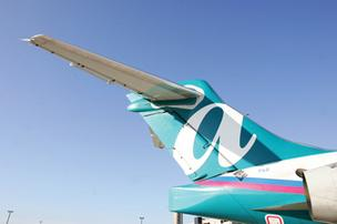AirTran Airways topped the Airline Quality Rating report, released Monday by Wichita State University Professor Dean Headley and his co-author, Purdue University Professor Brent Bowen.