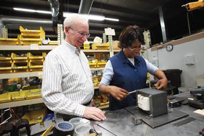 Badger Magnetics Inc. president Cliff Evans, left, said his company has tripled its staff and annual revenue since 2007.