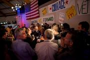 Reporters crowd around a Walker campaign official to get early comments.