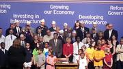 Community leaders and state legislators gather for the budget signing ceremony.