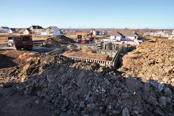 The Commerce Department's latest report on new residential housing construction shows a slowdown in May, although the headline number masks what was a gain in starts on single-family homes.