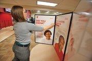 Megan Radowski sets up a diabetes display at the West Suburban YMCA.