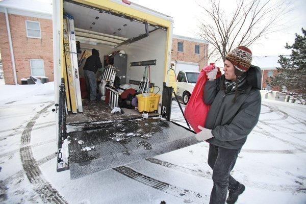 Victor Hernandez, a Beautiful Cleaning employee, loads an equipment truck.