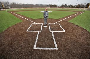 Patrick Ferry, Concordia University president, stands on the field of Kapco Park.