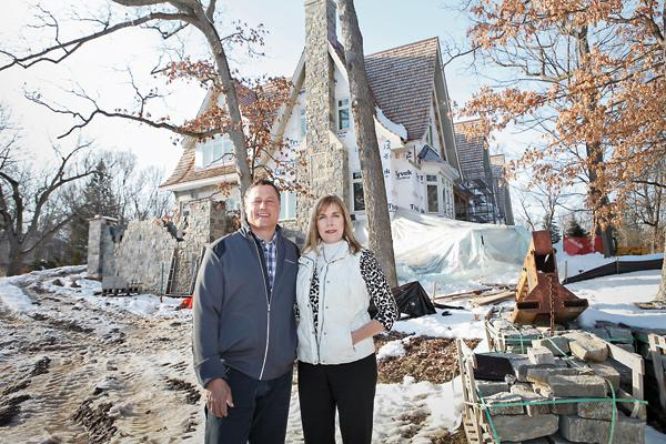 """David Moore (with wife, Lisa Moore) ...""""Our whole philosophy is about service and that's what has kept us alive and allowed us to grow."""""""