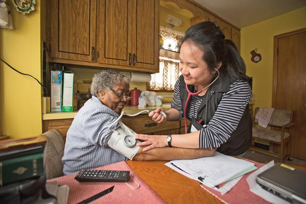 """Xao Thao (right)...""""When you see improvement in patients, it really feels rewarding."""""""