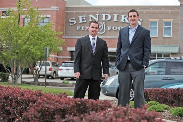 (From left) Steve Johnson, property manager for Brookfield Towne Center, which was recently purchased by Phillips Edison for $15.4 million, and David Roth, leasing manager for Phillips Edison & Co.