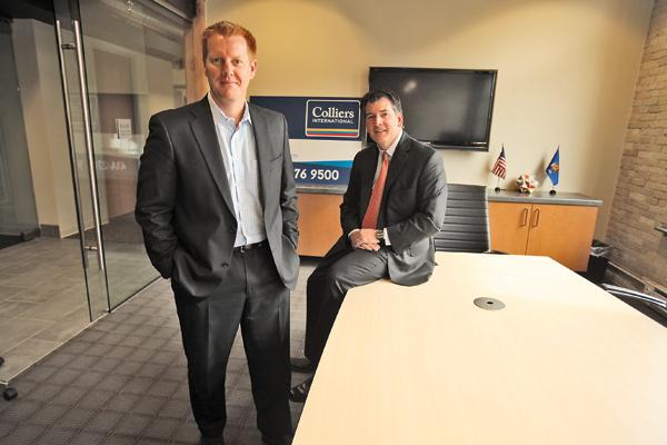 """Scott Welsh (left), with Mike Fardy... """"It gives us the credibility that we have a reach around the country and around the world."""""""