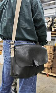 A messenger bag made of rubber inner-tubes is a new Flat Tire brand product.