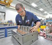 Plastic Components currently has 53 employees in Germantown, including 28 production workers.