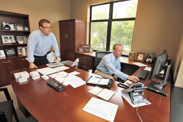 """James Cope of Walker & Dunlop Inc. (right, with senior analyst Dean Huber) . . . """"There's strong appetite and growth."""""""