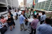 Young professionals along Milwaukee's river walk ready to get out on the water