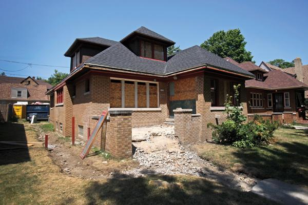 City officials are working with local groups to rehabilitate foreclosed homes in Milwaukee.