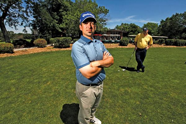 """Golf pro Eric Gitter (left) training Michael O'Neil at Currie Park Golf Club . . . """"I think we can get ahead of last year's numbers."""""""