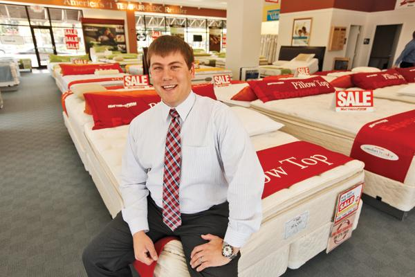 Mattress Firm's Brian Smith inside the company's Bayshore Town Center store in Glendale, one of 16 stores in southeastern Wisconsin.