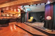 A rehabbed theater in the mansion's basement is used for video production and theatrical presentations.