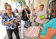 An enticing tray of desserts offered outside Sciortino's Bakery sparked the interest of (from left) Barb Sligl of Just for Canadian Doctors magazine, freelancer Mary Ann Anderson and Kevin Revolinski of The Mad Traveler Online.