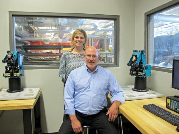 """Scott Jansen with Bradley Tech principal Jody Bloyer . . . """"We never thought we were in the service-providing business."""""""
