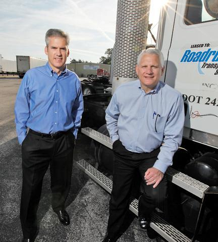 Mark DiBlasi (right, with Peter Armbruster) said Roadrunner Transportation had strong performance by all its business segments.