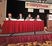 "Hospitality industry executives — (from left) Tim Dixon of the Iron Horse Hotel. Deno Yiankes of White Lodging Services, Milwaukee Marriott Hotel,  Kurt Schmidt of Potawatomi Bingo Casino, and Greg Marcus of The Marcus Corp. — spoke at The Business Journal's ""The Business of Growing Milwaukee"" Sept. 28."