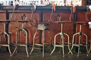 Barstools reflect the Iron Horse Hotel's chic industrial/ motorcycle design theme.