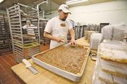 Miguel Sotomayor of Miller Baking Co. prepares products at the company's Milwaukee facility.
