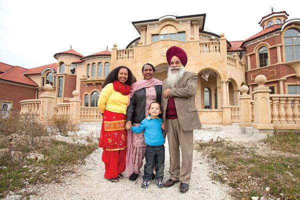 """Bachan Singh (at right, with family) . . . """"I don't think there's any other house like this in the whole state. This is a beautiful house."""""""